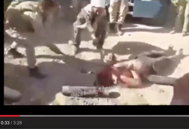 Militant Khomeinist pro-Iranian regime Iraqi Shia mullah strikes deadly blows on the head of a Sunni captive