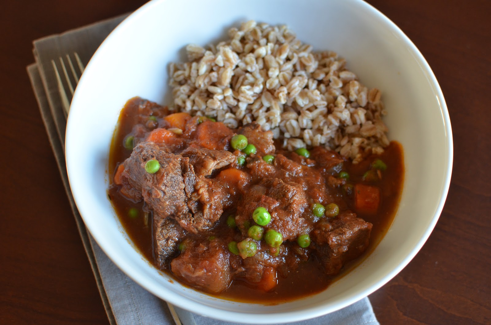 Beef and tomato stew made in the slow cooker, served with farro