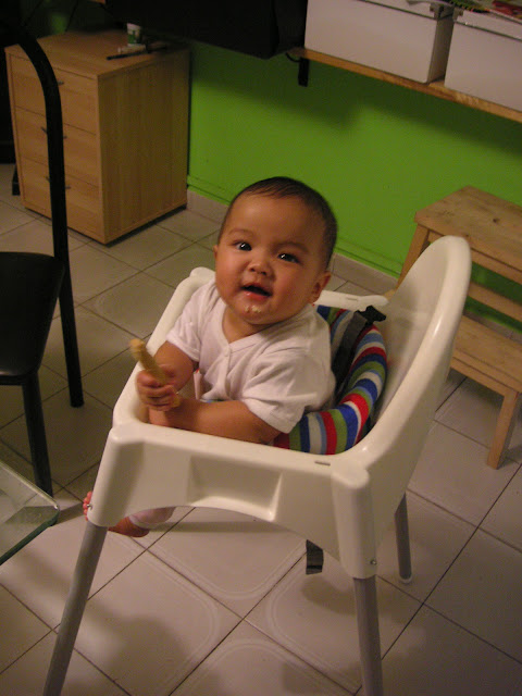 Kecil in baby chair at home