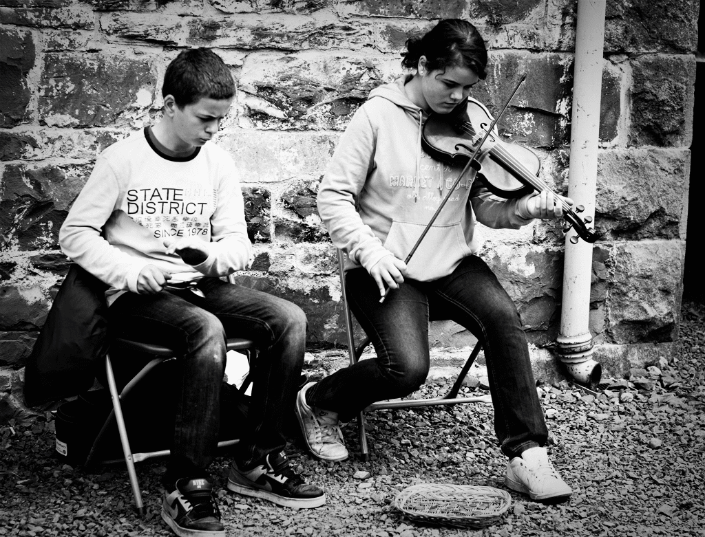 musicians playing the spoons and fiddle