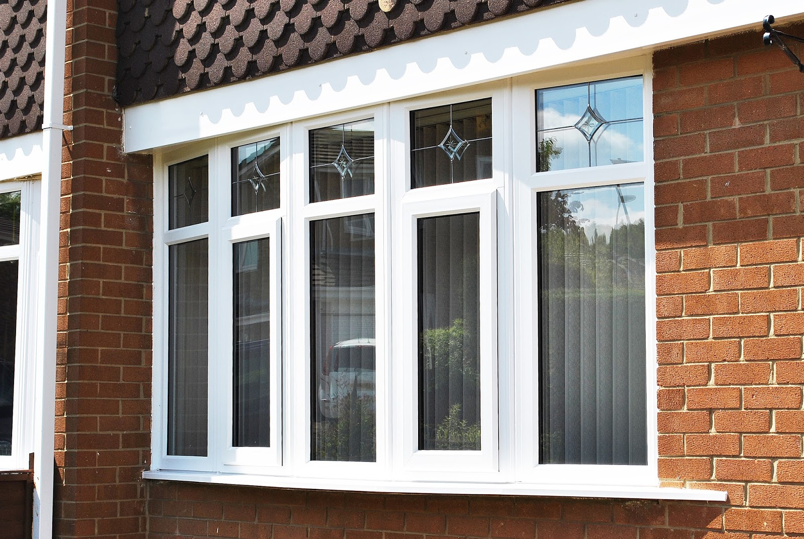 Beautiful upvc rehau lincoln door and windows with sparkle glass design in side panels and top Upvc window designs for homes