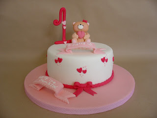 The Sugar Fury Baby Girl First Birthday Cake
