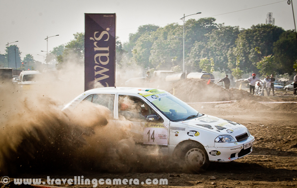 Last week, a motorsport event took place in Mohali (Near Chandigarh), which was organized by OYA Auto Cross and Motorcross. JK Tyre was one of the main sponsor of this event and it continued for three days. During final day I also visited the ground to bring this PHOTO JOURNEY for you. Let's check it out...Cars were literally flying on this ground and whole region was full of dust only. At times it was difficult to see these moving cars. It was hard to imagine that we were standing on a ground which is not in states like Rajasthan. The only word was coming to my mind at that point of time - Dust-Storm, like the one happens in Rajasthan; 'Desert Storm'... Let's check out more photographs from this series of Dust-Storm in Chandigarh...Different types of Cars and Bikes participated in this event, but cars competitions were mainly compelling us to rename it as 'Dust Storm'. Only two cars at a time were enough to cover sky with dust.I am not sure what this 'Dewars' was, but various pillars were planted on this ground. These should be some brands who supported this motorsport event. Barista was also there to serve snacks and drinks, but not sure if they were sponsors or not.Different cars by Honda, Maruti, Mitsubishi & Toyota participated in this event. At times, it was hard to believe that some specific cars can fly like this... One of the rider was very well controlling a white Swift, and it was competing with a 4 by 4 Jypsy...These cars were making the ground-dust to fly in air and at times, they used to cover themselves by dust storms. Specifically, there was huge dust on taking any turn.A colorful Maruti Car going down into a tunnel which was created artificially on this ground for Motorcross competitions during 3rd OYA sports-event.Passion of all these riders was commendable and it was hard to imagine that human beings were driving these super-machines.'Dust Storm' is something coined on run-time and not related to this event.I tried to check about this event on FMSCI website but couldn't find any details. Website of OYA was not much helpful for me to get information as non-motorsport person. Anyway, please have a loo at following link to know more about the organization which organized this event in Mohali - http://oyamohali.comWhole ground was surrounded by lot of people who wanted to see these races, but unfortunately the dust was biggest enemy. After one lap of car racing, there was nothing visible on ground. So everyone was more excited about bike racing, which had more participants at one point of time and things were visible as least.Motrosports in India is one of the increasing passion among people in cities like chadigarh. Now India is also getting some powerful machines, which was not that easy few years back. But still lot of folks can't afford these powerful machines without sponsorship and in such competitions, it's not easy thing to compete with imported machines with our usual bikes.Another shot where another car is contributing to Dust Storm on this ground in Mohali, Punjab, INDIA...After lot of dust in above photographs, I also thought of sharing some bike photographs to show another side of the PHOTO JOURNEY...It seems that bikers in such competitions also use their legs as supporting equipment while turning these machines on extremely high speed.With this, let me finish this Photo Journey of Dust Storm in Chandigarh (Mohali, Punjab)