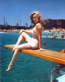 Marilyn Monroe sitting on dock