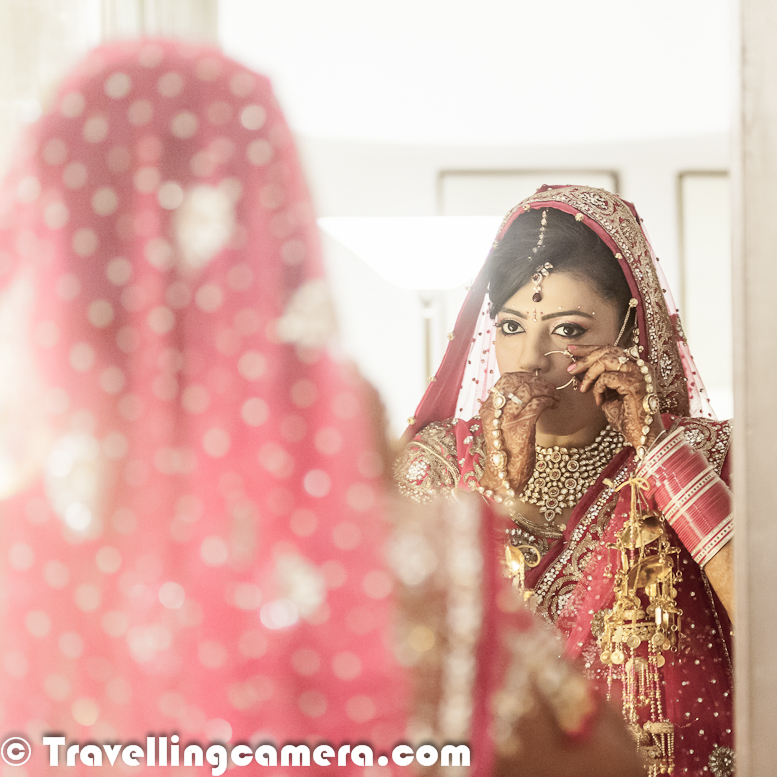 Indian Weddings are quite interesting to photograph and capture these moments to cherish forever. In different states of India, different rituals are associated with regional weddings, but the common part is colorfulness. Let's check out this Photo Journey to check out colorful moments with Indian Bride.. Indian Brides ensure the best dresses for their weddings along with appropriate jewellery and other relevant stuffLehnga-Choli is main dress for Brides in Indian Weddings. Wedding in India is a very special occasion of life and people spend a lot on everything associated. On same lines, if we go online or in markets to search Lehnga-Choli, there would hundreds of types of Lehnga-Choli. I just spent 10 minutes on web and got to about various types like Jodhpuri n all, but I am amazed to categorization on the basis of ceremonies which take place in an Indian Wedding. Like Sangeet Lehnga-Choli, Mehndi Lehnga-Choli, Reception Lehnga-Choli etc..Since there is huge demand for Wedding Appareals in India, there is a huge supply of designer Lehnga-Choli as well. Every city in India has various designers who are only focused around weddings. And these are dresses are not limited to Lehngas only. There are many couples who want to try something different in Indian or western version.The market for Bridal dresses is quite big and at the same time demand for various options in Groom dresses is also increasing quite fast. Sherwanis, Indo-Western Suites etc.. Venues for Indian Weddings are also very special. With time trends are changing but still there is huge demand of different types of places. Usually huge number of friends & relatives join together to celebrate this moment. Still some families celebrate the main ceremony with everyone and at times, invitees are divided into different ceremonies. Venues are arranged accordingly. Usually huge farms are preferred for main ceremony and if someone decides to have lesser number of guests, number of options increase as various good hotels are decent space to host marriages. Trend of Wedding planners is also increasing in India. A wedding planner is a professional who assists with the design, planning and management of a client's wedding. Weddings are significant events in people's lives and as such, couples are often willing to spend considerable sums of money to ensure their wedding is organized as perfectly as possible. Professional wedding planners exist throughout the world, most notably in the USA, UK and Western Europe. There are various wedding planning courses available to those who wish to pursue the career. Wedding planners are often used by couples who work long hours and have little spare time available for sourcing and managing wedding venues and wedding suppliersIndian weddings are filled with ritual and celebration that continue for several days. Generally anywhere between 200 to 5000 people attend. Many of the attendees are unknown to the bride and groom themselves.  The traditional Indian wedding is about two families being brought together socially, with as much emphasis placed on the families coming closer as the married couple. Many wedding customs are common among Hindus, Jains, Sikhs, and even Muslims. They combine local, religious and family traditions. The period of Hindu marriage ceremonies dates from the application (lagan) of tilakIndian weddings are a mainstay in the social calendar of the whole community. Many wedding traditions that originated in India, Pakistan and Bangladesh carried over to immigrant populations. Increasingly, Western features are incorporated, such as speeches, the first dance and the traditional wedding cake. Indian weddings are typically lavish - which costs a lot to the family.A non-Indian guest wondering about the fat Indian Weddings and detailed rituals to be followed for starting a married lifeFamily priest is one of the important person in Indian Marriages, who is required in almost every ceremony related to weddings in India. Some of the common cemermonies in Indian Weddings are -Sangeet, Mehndi, Kanyadaan, Bariksha, Tilak, Lagn, 7 Vachan, fere, Flower bed Ceremony, Vidai etc.professional Indian Wedding Photographer VJ Sharma | Indian Wedding Photography | Top Wedding photographers in Delhi | Couple shoot Photographs | Pre-Wedding Photo shoots | Post Wedding photo Shoots | Candid Wedding photography | Fine Art Wedding Photography