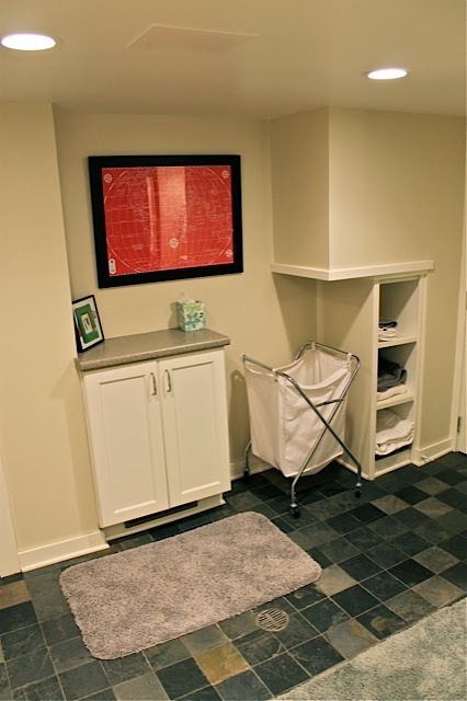 The Side Area Where The Chimney Was Is Now A Simple Set Of Shelves And The  Exit For The Laundry Chute. A Small Narrow Cabinet Works As A Welcome  Countertop ...