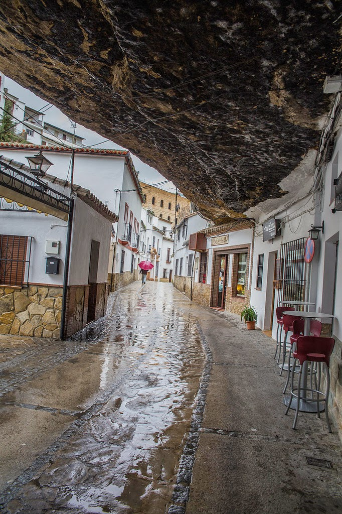 When first settled, this area actually made an excellent place to live: The shadows of the gorge provided a natural way for people to stay out of the heat. - The People In This Spanish Town Are Literally Living Under A Rock.
