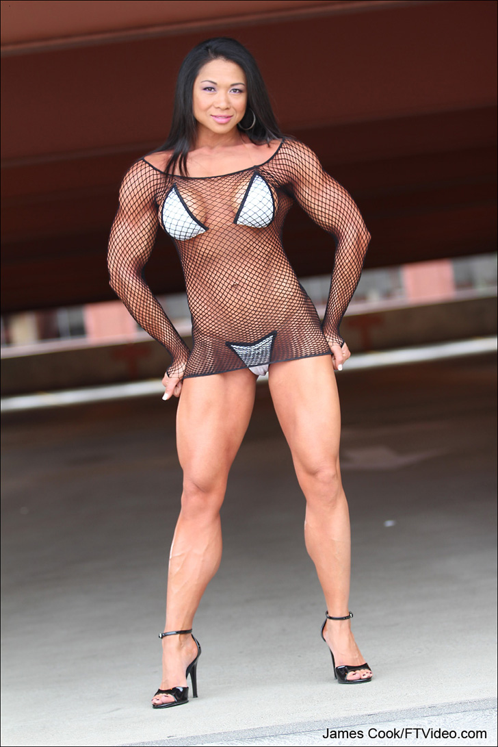 Janet Rosa Modeling Her Muscular Body In A Bikini And Heels