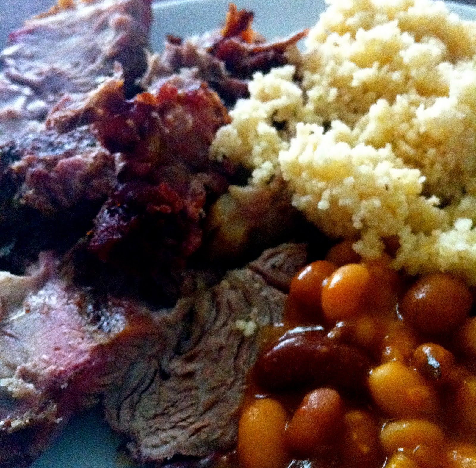 Slow Roasted Shoulder of Lamb with spicy mixed beans and couscous