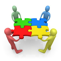 group collaborating with puzzle