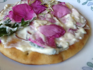 image Kawartha Lakes Cottage Treat - Naan with Wild Edibles Nean bread round topped with wild edible infused cream cheese