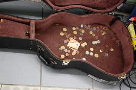 THROW SOME CHANGE INTO THE GUITAR CASE, MAN!