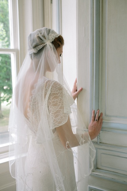 Vintage lace veil to complement a 1930s wedding dress - three-quarter view from behind