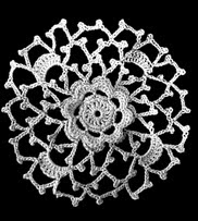 http://www.ravelry.com/patterns/library/irish-crochet-flower-medallion