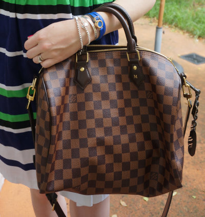 Louis Vuitton Damier Ebene 30 speedy bandouliere with Coach feather bag charm