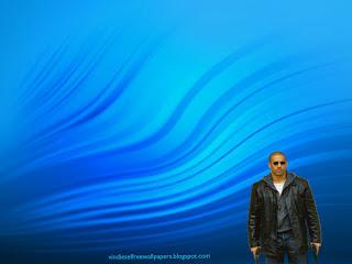 Desktop Wallpaper of Vin Diesel action movie actor with two guns in Ripple Landscape Desktop Wallpaper