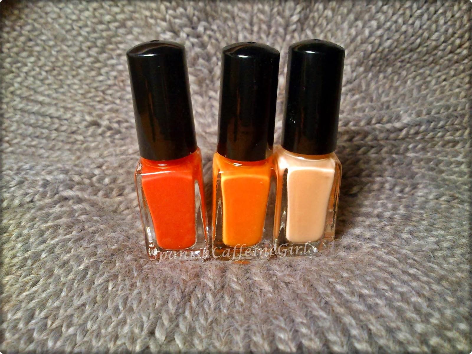 3 botes de esmaltes de uñas naranja