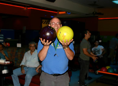 GotPrint employee weighing his options with two bowling balls