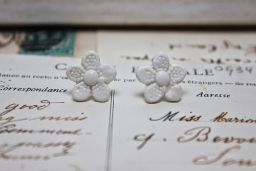 http://www.amanda-mercer.co.uk/pretty-things-for-you/daisy-button-stud-earrings