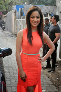 Actress Yami Gautam Pictures in Orange Dress at Feminas Salon