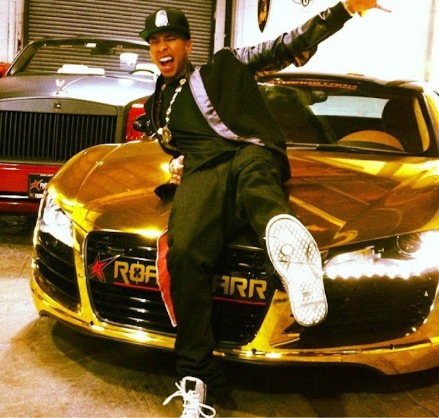 SEE PICTURES OF GOLD PAINTED AUDI R8 GT AND TOILET SEAT BELOW   Tyga Gold Iphone