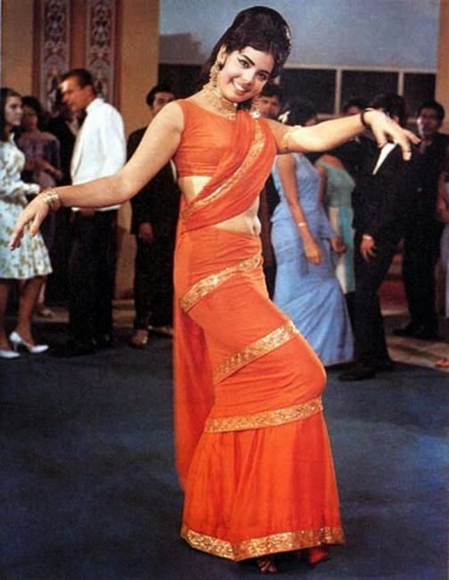 The classic famous look known as mumtaz style drape. Red and Blue  Dunno what to do    Bollywood retro theme    lets