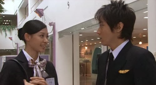 Tsutsumi looks troubled as the cabin attendant rejects him.