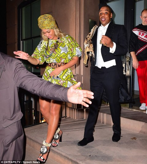 Jay Z and Beyonce dress as Eddie Murphy and co-star in Coming to America for Halloween
