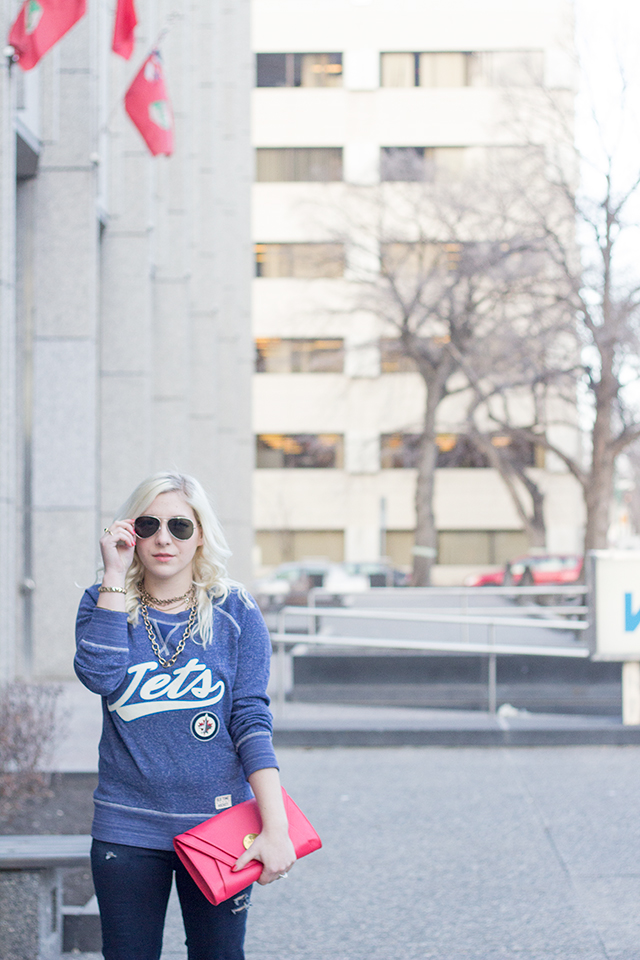 Navy blue vintage inspired Winnipeg Jets sweater.