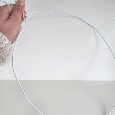 A typical english home how to make a bauble wreath take your wire hanger and untwist the ends bend the coat hanger into a big circle solutioingenieria Choice Image