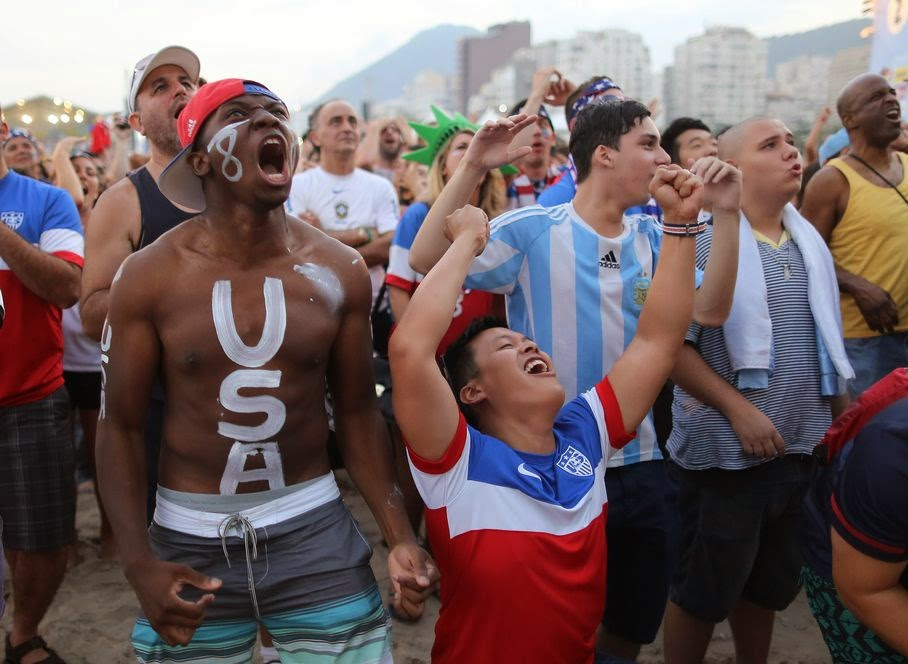 U.S. soccer fans watch their team's World Cup round of 16 match against Belgium on a live telecast inside the FIFA Fan Fest area on Copacabana beach in Rio de Janeiro, Brazil, Tuesday, July 1, 2014.