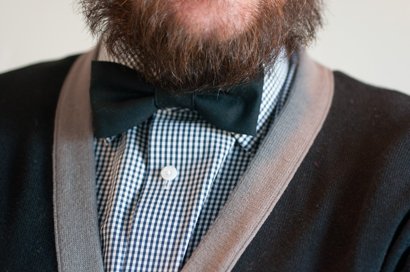 bow tie, black bow tie, black bowtie, kelsey bang bow tie, beard, mens style, handsome man, handsome guy, plaid shirt, nordstrom, nordstrom shirts, plaid shirt, black and white, 2 tone cardigan, gray and black cardigan, ryan renoylds, urban outfitters, ryan renoyolds look alike, mens profile, mans beard, big beard, mens style, fashion, mens wear,