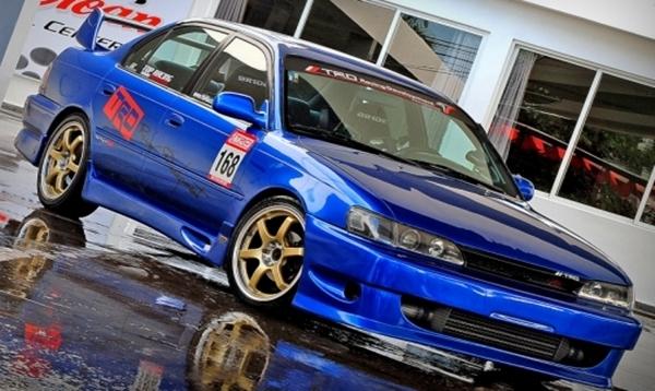 Custom Racing Street Toyota Corolla In Blue Metallic Lowrider Look With Door Number Sticker