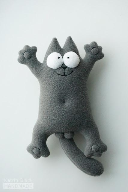 Серый кот Саймона - мягкая игрушка.