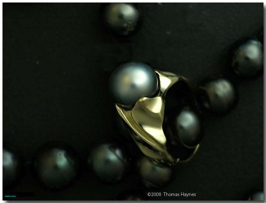 14 karat light yellow gold ring containing large Tahitian pearl