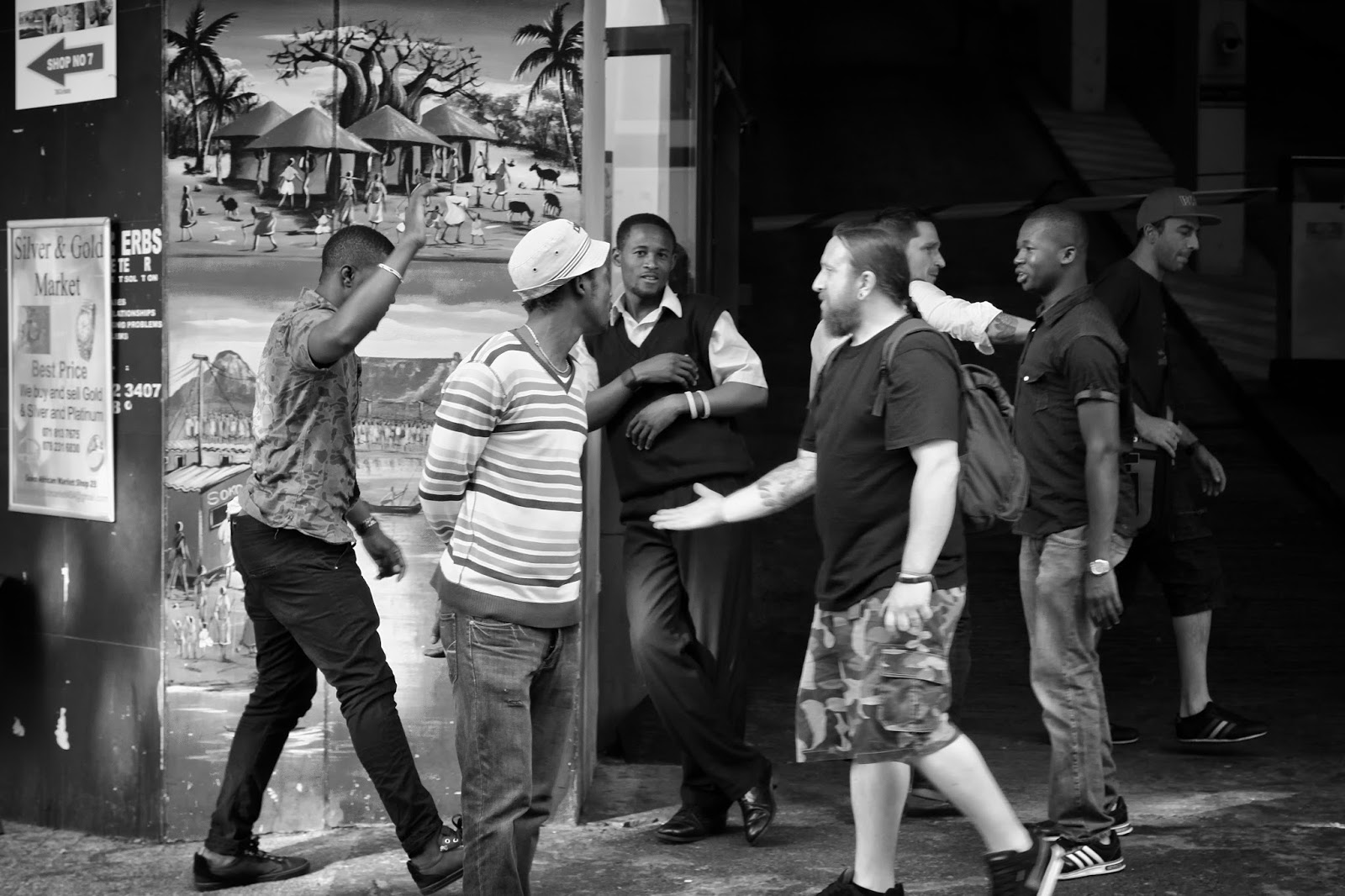 Two mean give each other some skin in this street photo