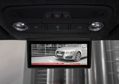 Audi's digital rear-view mirror, which made its debut in the R18 e-tron Quattro and R18 ultra race cars at this year's Le Mans 24 Hours, is set to enter small scale production at the end of this year in the Audi R8 e-tron. Unlike previous rear-view mirrors from the likes of Ford, Toyota and Mazda, which dedicate only a percentage of the mirror's surface area to displaying vision from a rear-view camera, Audi's digital rear-view mirror does away with the conventional mirror altogether.
