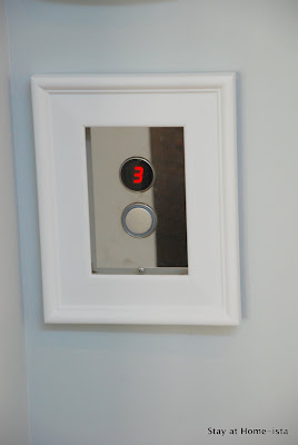 using a frame to frame-out an elevator call button