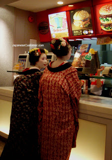 Geisha ordering fast food Copyright Peter Hanami 2009