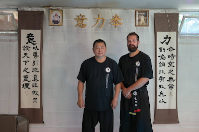 Tempe, AZ martial arts instructor Ashe Higgs poses with GM Sam Chin