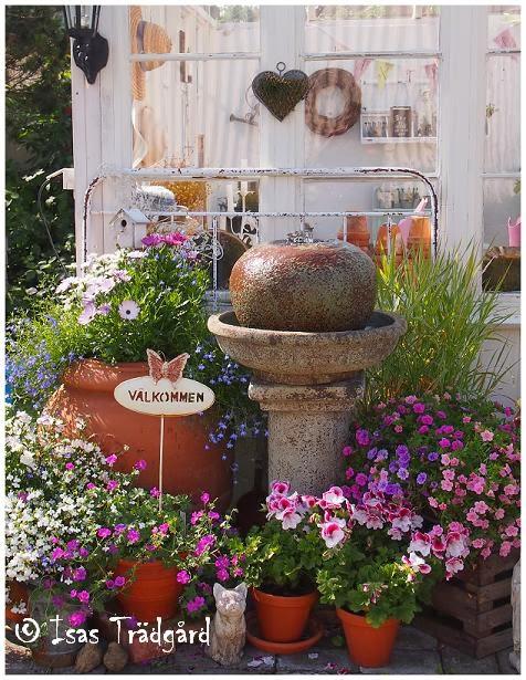 Fontänen framför växthuset