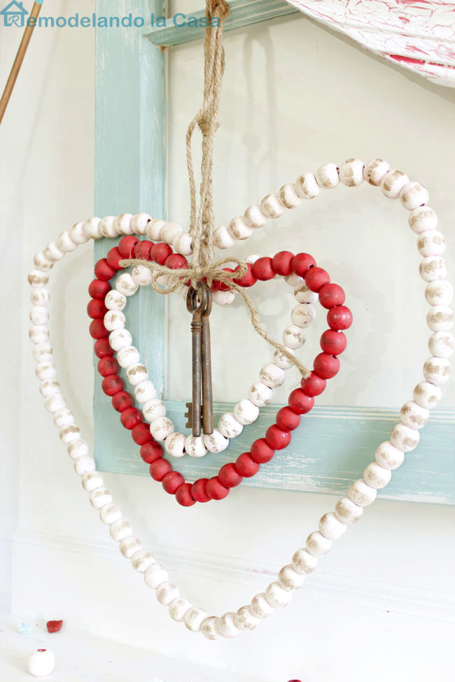 red wooden bead Christmas garland was repurposed into beaded hearts for Valentines