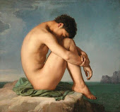 Young Man Sitting by the Seashore