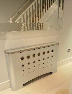 Modern bespoke radiator covers in galvanised metal