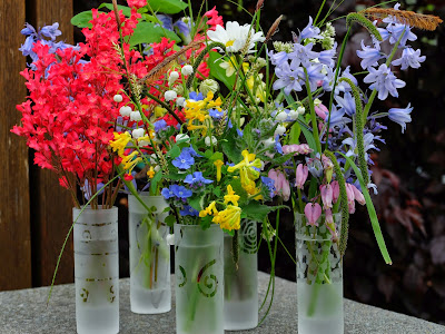 Five Small Vases of Spring Flowers