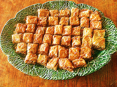 green ceramic platter of Greek pastry
