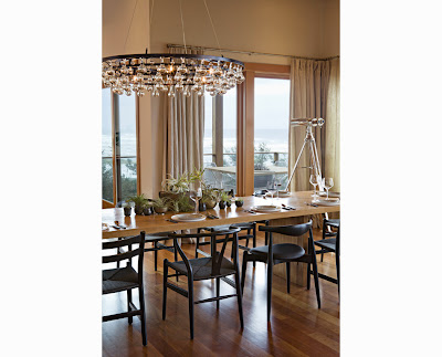 dining room with interesting centerpieces surrounded by enormous light