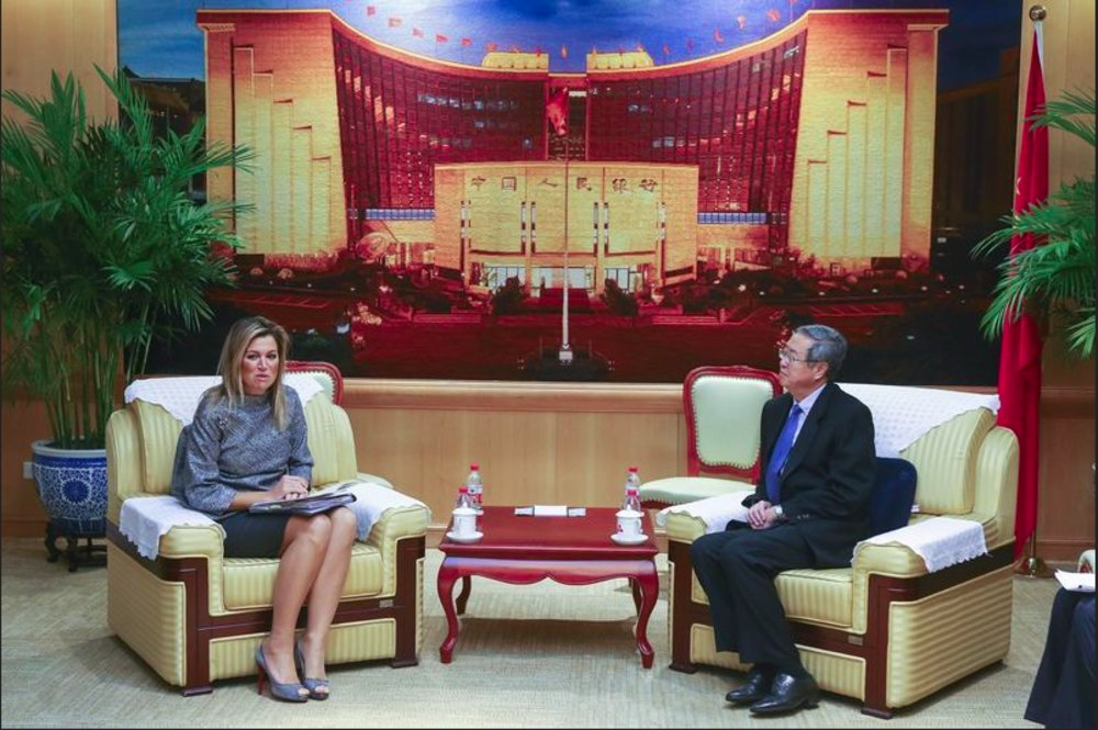 Queen Maxima of The Netherlands meets with officials of the Bank of China, in Beijing, China.