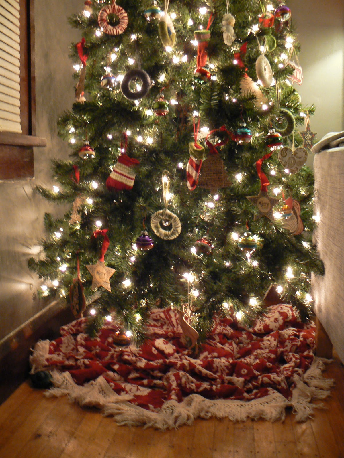 this blanket does the job of a real tree skirt just as well as a store bought one you could also use a sheet a sheepskin a small rug spare fabric - Cheap Christmas Tree Skirts