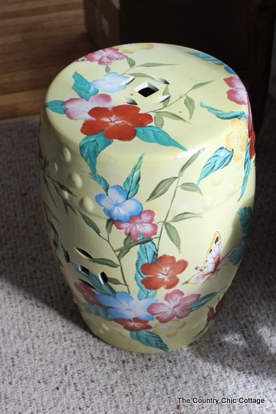 Spray paint a garden stool for a Ballard knock off -- perfect for your summer decor!